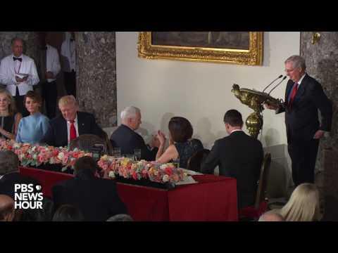 Senate Majority Leader Mitch McConnell toasts President Donald Trump
