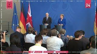 جونسون يبحث مع ميركل خروج بريطانيا من الاتحاد الأوروبي
