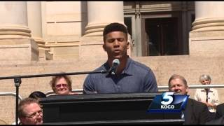 Student reads powerful poem at Teachers Rally