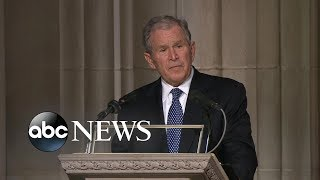 George W. Bush eulogizes his father through tears, laughter