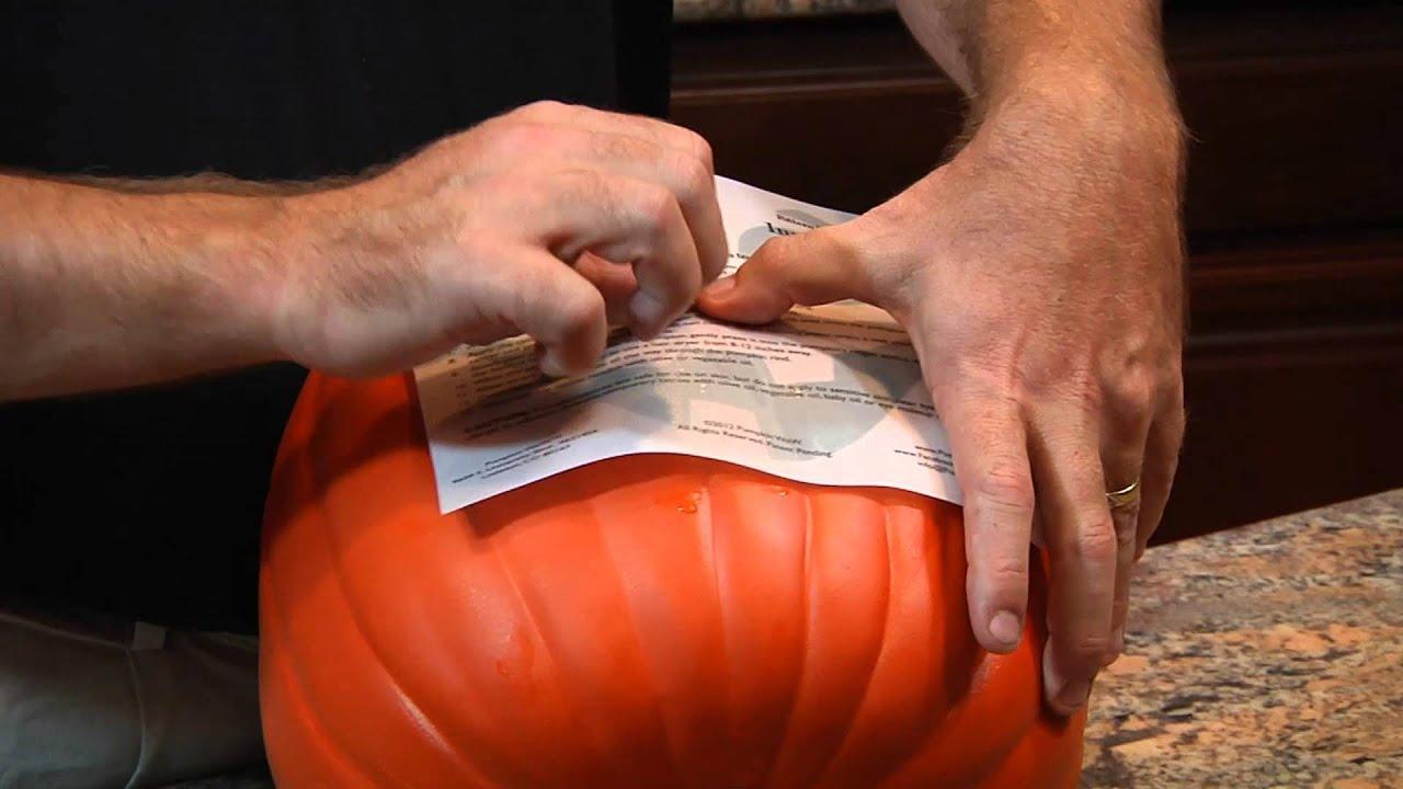 PumpkinWow! Applying a pumpkin tattoo.