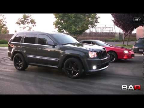 Jeep SRT8 vs Camaro SS Drag Race
