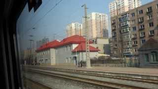 preview picture of video 'Budowy osiedli za oknem pociągu z Shenyang do Beijing'
