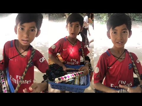 A Khmer boy showing off his linguistic talent while trying to sell souvenirs to a tourist in Cambodia