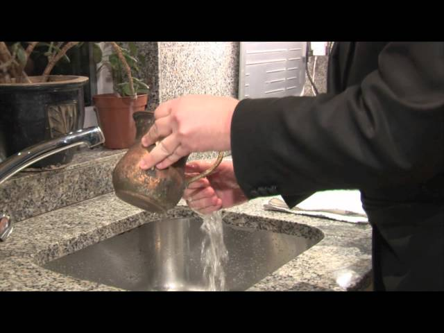 The Blessing for Washing Hands Before Eating Bread
