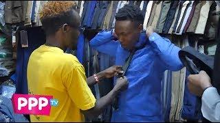 Ajaabu and George Ndung'u [ the Street Boy ] wardrobe change.