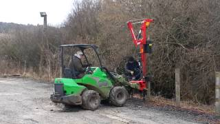 RMC ~ Avant 635 with Post rammer knocking in fence posts to provide anchor for kick boards