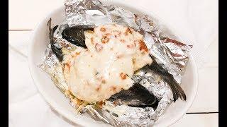 Рыба Дорадо, фаршированная овощами и креветками, запеченная в духовке