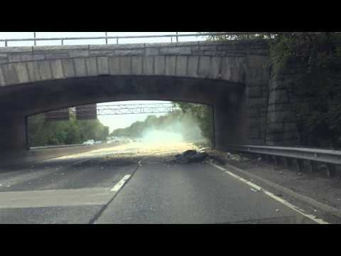 Truck smashes into overpass