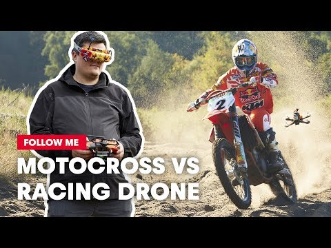 fpv-racing-drone-films-a-motocross-racer-shredding-a-sand-track--follow-me