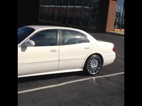 "2003 Buick LeSabre sitting on 20"" Divinity D18 Chrome wheels and 245/35-20 Lexani tires."