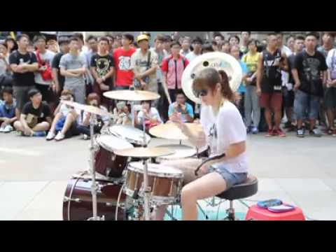 Taiwanese girl drumming on the street