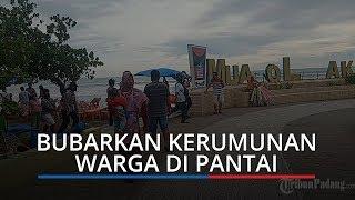 Polisi Sasar Pantai di Kota Padang, Bubarkan Masyarakat yang Nongkrong Lalu Bagikan Uang