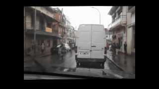 preview picture of video 'Driving with a car in the rain through Antsirabe'