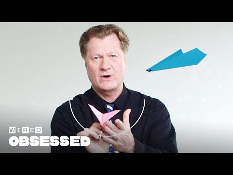 Guy explains how to fold world record paper airplanes