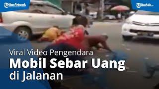 VIRAL Video Pengendara Mobil Sebar Puluhan Lembar Uang di Jalan, Sempat Buat Jalanan Macet