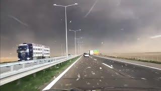 Смотреть онлайн Как выглядит песчаная буря на трассе