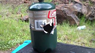 Shooting a small propane tank WITHOUT tracers which means NO explosion so DON'T! flame the comments