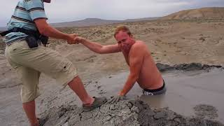 guy gets stuck in quicksand mud...