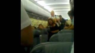 women gets kicked off plane kicking and screaming