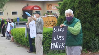 Demonstrators stand witness for George Floyd