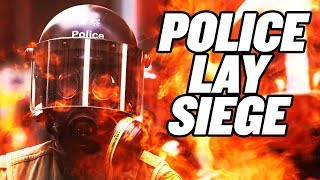 Hong Kong Police Lay Siege to University Students