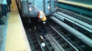 MTA Worker Retrieves Ball (7)