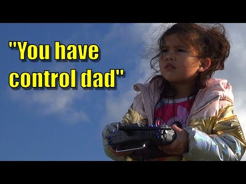 daughter-teaches-father-to-fly-rc-plane