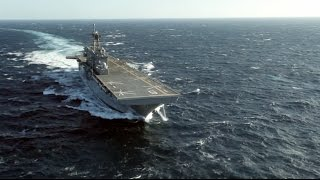 These are the small, agile new aircraft carriers meant to take F 35s into battle