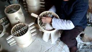 preview picture of video 'china, qufu city centre, production of bambu steam baskets'
