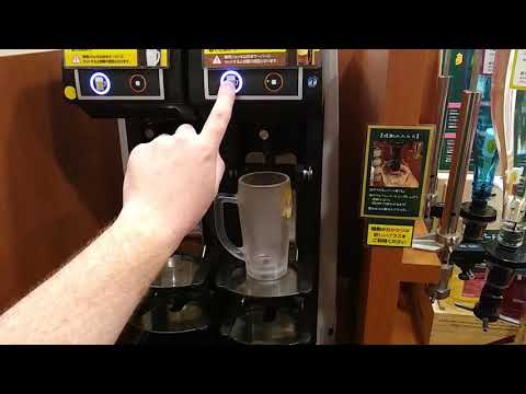 Self pouring beer machine at a Japanese all you can drink restaurant.