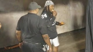 LOL! Marshawn Lynch Eats Chicken Wings While Walking onto the Field for Preseason Game