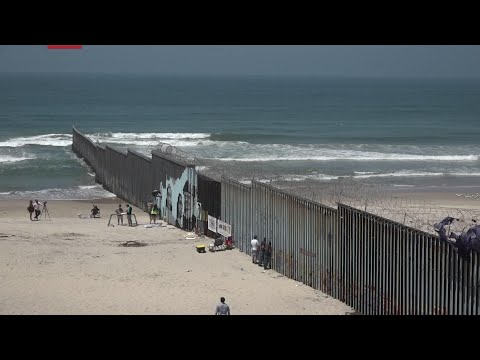 Border mural depicts adults who came to the US illegally as children and were deported. The mural uses scanning codes to tell the stories including, that of a deported US veteran and two mothers with children who were born in the US. (August 9)