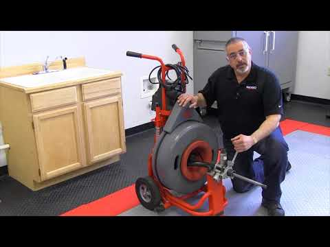 How to adjust the power feed on the RIDGID K7500 drum machine