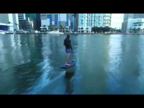 Flying above the water in a battery powered, hydrofoil surfboard