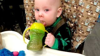 LEARNING TO USE A SIPPY CUP