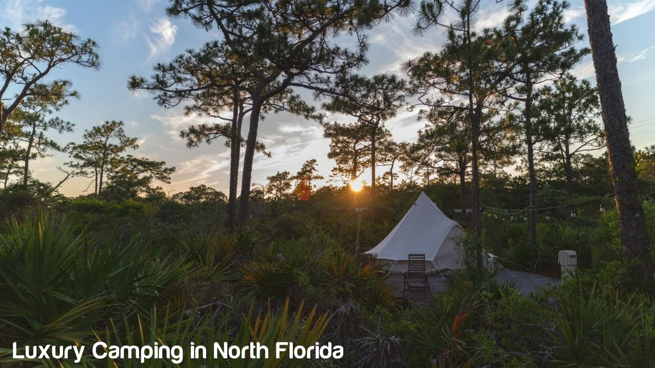 Luxury beach camping tent in north Florida with the sunset in background