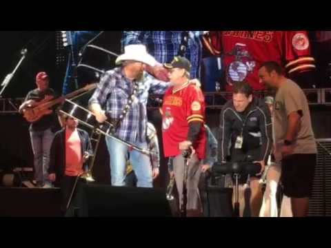 Toby Keith pulls up a marine vet during his encore performance