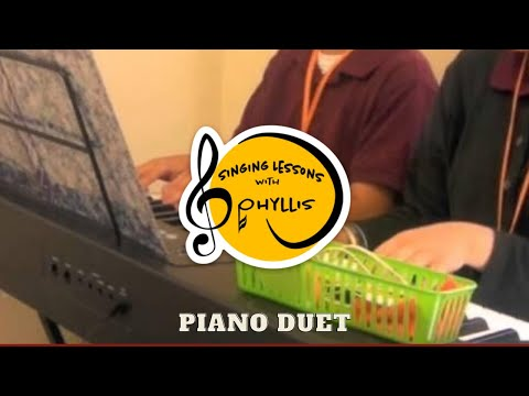 Piano duets can be fun!  Students working together!