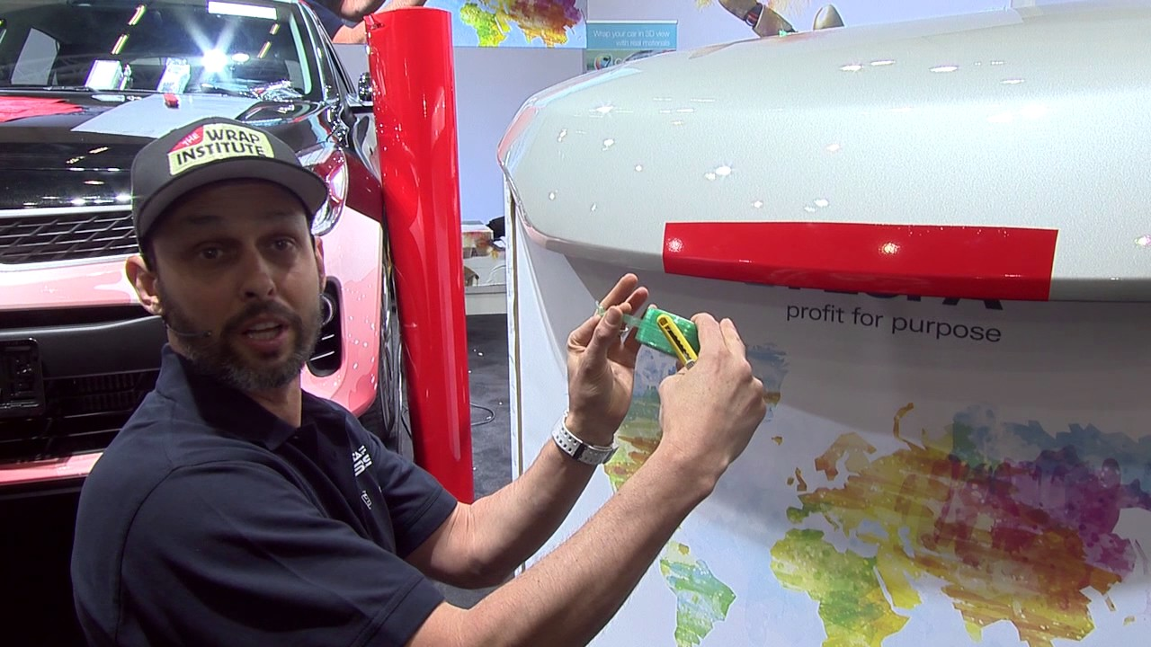 <p>World Wrap Masters Judge and professional graphics installer, Justin Pate demonstrates the importance of cutting down on cutting</p>