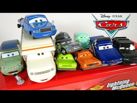 NEW DISNEY PIXAR CARS 2 CHARACTERS POLICE LARRY CAMPER MILES AXELROD TOKYO DRIFT PARTY