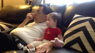 Baby laughing at Farmers Insurance Hotdog Commercial