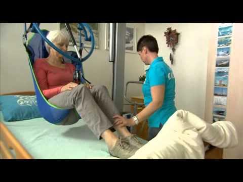Ergocoach film: met passieve lift van rolstoel naar bed