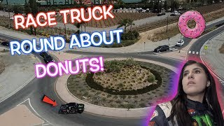 DONUTS AROUND A ROUND ABOUT IN A RACE TRUCK!!! Hailie Deegan!
