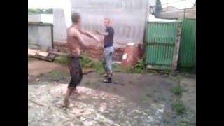 Two drunken men fighting