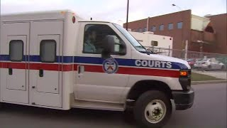 Police vehicle with van attack suspect appears at court
