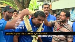 Social media appreciates Kerala fisherman Jaisal ,who bends down  for women to get into rescue boat
