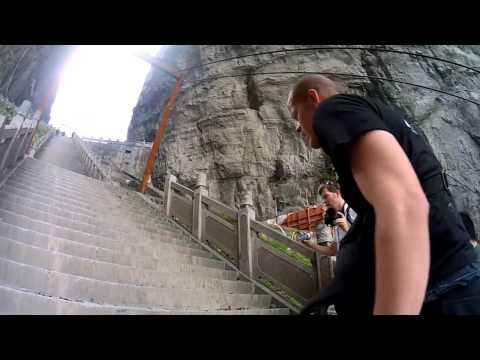 Jeb Corliss Flies Through Tianmen Cave