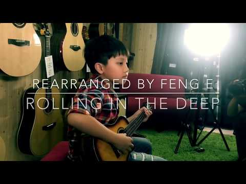 Kid plays his own incredible arrangement of Adele's Rolling In The Deep on ukelele