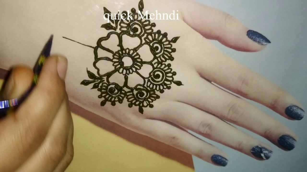 beautiful floral arabic mehndi design for back hand by quick mehndi